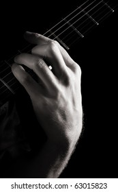 Major chord (A) on electric guitar; toned monochrome image