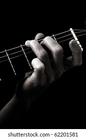 Major  chord (G) on classical guitar; toned monochrome image;
