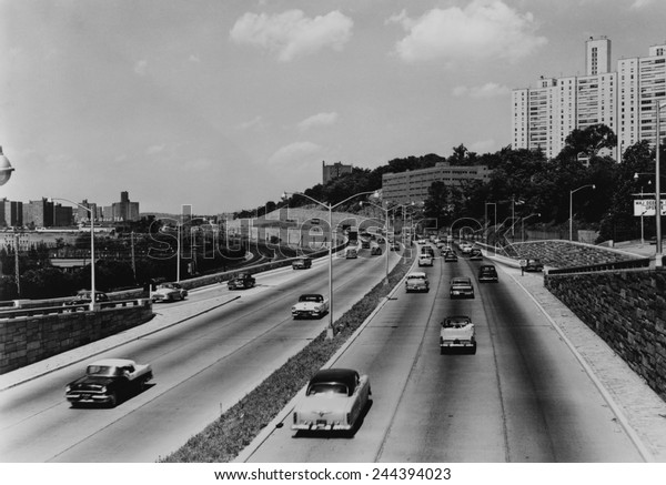 Major Deegan expressway seven miles outside New York City has six lanes to accommodate increasing suburban commuter traffic in 1957.