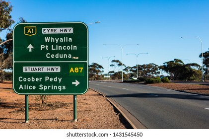 A major road sign that will send you in one of two very different directions, continue along the road to head toward Perth and Western Australia, take the right and you're going to Darwin and the NT