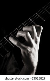 Major seventh chord (Amaj7) on electric guitar; toned monochrome image