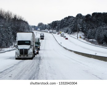 Major snow storm causes traffic delays on highway.