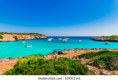 Majorca Island, Mediterranean Sea with turquoise blue sea water and anchoring boats at the beautiful bay of Cala Varques, Spain.
