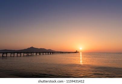 Majorca Muro beach sunrise in Alcudia Bay Mallorca at Balearic Islands of Spain.