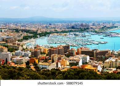 Majorca, Spain. Aerial view of Palma de Majorca - main city in Balearic islands, Spain. Port and old town taken from the castle. Many modern hotels and apartments and mountain at the background.