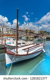 Majorca, Spain - June 1st 2018: Old wooden fishing boats at harbour port of Sa Coma on Mallorca island