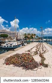 Majorca, Spain - June 1st 2018: Fisher net at fishing harbor port of Sa Coma, Mallorca, Balearic islands