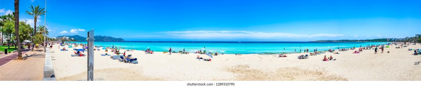 Majorca, Spain - June 1st 2018: Beautiful sand beach panorama at seaside of Cala Millor on Mallorca island, Mediterranean Sea