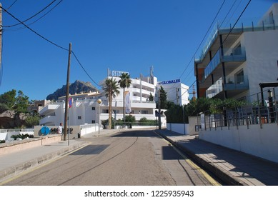 MAJORCA, SPAIN - OCTOBER 2, 2018: Hotels and tavernas on the Carrer del Temporal at Cala San Vicente on the Spanish island of Majorca. The resort town is comprised of four separate coves.