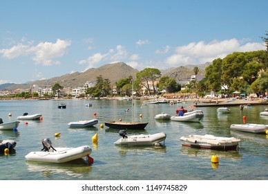 MAJORCA, SPAIN - SEPTEMBER 5, 2017: Dinghies moored on the seafront at Puerto Pollensa on the Spanish island of Majorca. The popular resort is the most Northerly on the island.