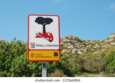 MAJORCA, SPAIN - SEPTEMBER 5, 2017: A Government sign warning of the risk of fire by the Tramuntana mountains at Puerto Pollensa. The sign marks the start of the Boquer valley walking trail.