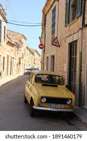 Majorca,Spain-August 29,2015 : Yellow Renault parking on local street in Majorca. Groupe Renault is a French multinational automobile manufacturer established in 1899.