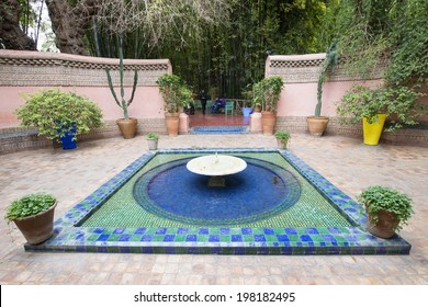 MAJORELLE GARDEN, MARRAKECH, MOROCCO, MAY 11, 2014. A shallow fountain at the entrance of the former adobe of the fashion guru Yves Saint-Laurent, in Marrakech, Morocco, on May 11th, 2014.