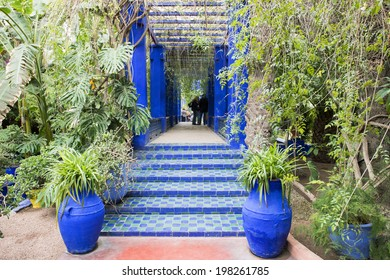 MAJORELLE GARDEN, MARRAKECH, MOROCCO, MAY 11, 2014. The blue entrance of a covered in the garden of the former adobe of Yves Saint-Laurent, in Marrakech, Morocco, on May 11th, 2014.