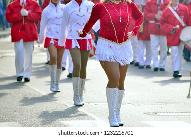 majorettes with white and red uniforms perform in the streets of the city. photographic series