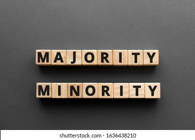 Majority minority - words from wooden blocks with letters, majority minority concept, top view gray background