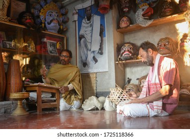 Majuli, Assam/India- January 9 2017:  Hemchandra Goswami, who is widely acclaimed for his extraordinary skills of mask making, absorbed in his creation. (Chamaguri Satra, Majuli, Assam)