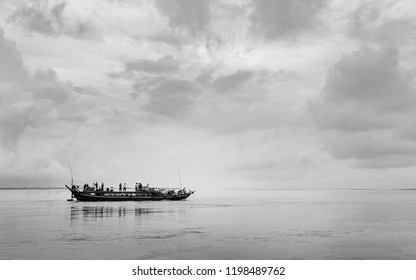 MAJULI, INDIA - AUGUST 23, 2011: Public ferry loaded with passengers and cargo crosses flooded Brahmaputra river on August 23, 2011 near Majuli, Assam, India.