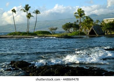 Makaiwa Bay with ancient hawaiian home in the distance, near Mauna Lani resort, on the Kohala coast, Big Island, Hawaii