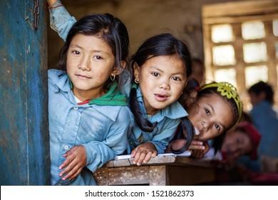 MAKALU, NEPAL - NOVEMBER 15, 2016: Childern in a small village Tashigaon school in Makalu peak region. School is recovering from huge earthquake in 2015 in Nepal. 2016
