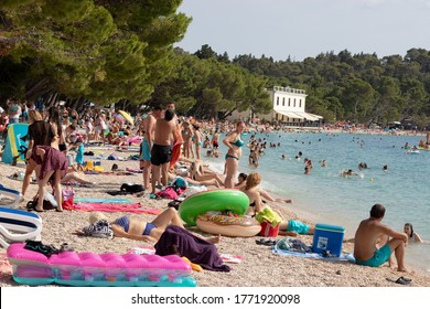 Makarska, Croatia July 2020 Start of the summer season in Croatia. Popular public beach in Makarska. Overcrowded beach as usual even in times of covid outbreak, people are still advised to take care