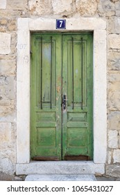 MAKARSKA; CROATIA 29 JUNE; 2017: Vintage Green Wooden Doors In Old Marble
