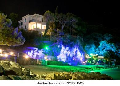 Makarska, Dalmatia, Croatia, Europe - AUGUST 23, 2017 - Deep cave arch disco at the beach of Makarska