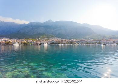 Makarska, Dalmatia, Croatia, Europe - Skyline of Makarska in front of the huge mountain massif