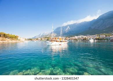 Makarska, Dalmatia, Croatia, Europe - A touristic party boat leaving the harbor of Makarska