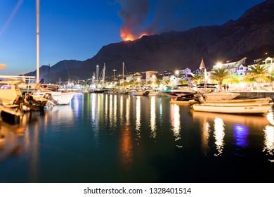 Makarska, Dalmatia, Croatia, Europe - A wildfire in the mountains of Makarska at night