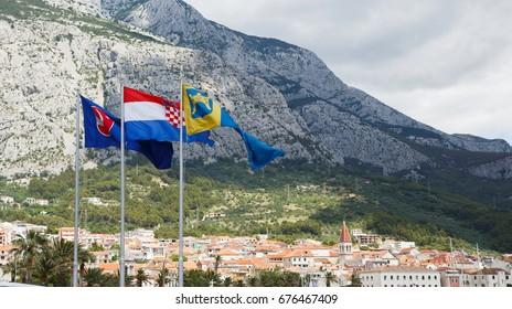 MAKARSKA,CROATIA - 18 JUNE,2017: National Croatian flag close up.Symbol of Croatia country & Dalmacia region in windy summer day.