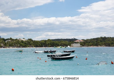 MAKARSKA,CROATIA-18JUNE,2017: Small rental boats floating on water in harbor.Tied to pier water crafts drifting on waves.Take a boat for rent during summer vacation trip.Rent a yacht for vacation trip