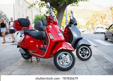 MAKARSKA,CROATIA-3 MAY,2017:Motor bikes parked in city street. Small scooters for rent in popular tourist destination.Rental motorbikes on parking.Red scooter for city.Rent urban transport