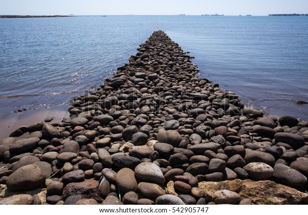 Makasar, Indonesia-pile of rocks at the seaside in Makasar Indonesia