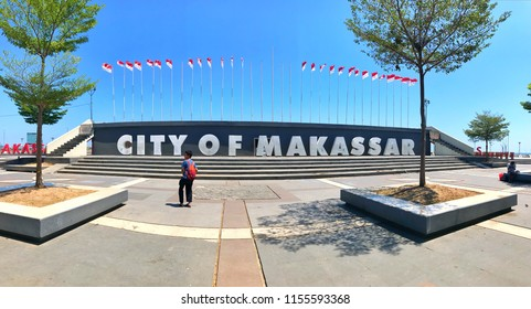 MAKASSAR, INDONESIA - AUGUST 14 2018: Panorama at Losari Beach Pavilion which reads City of Makassar which is often a tourist destination. Losari Beach is located on the outskirts of Makassar