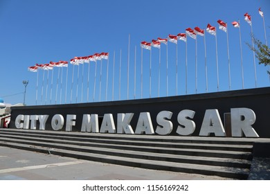 MAKASSAR, INDONESIA - AUGUST 14 2018: A number of Indonesian flags lined up at Losari Beach in Makassar City. The flag was installed to commemorate Indonesia's independence