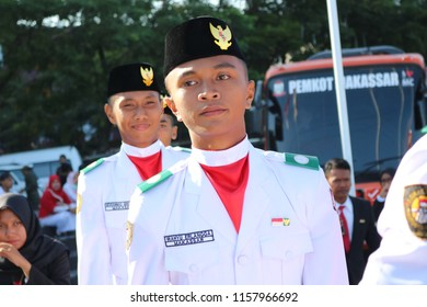 MAKASSAR, INDONESIA - AUGUST 17 2018: Members of the flag raisers (paskibraka) who were standing in the sun while waiting for the Indonesian flag-raising ceremony at Losari Beach Pavilion, Makassar