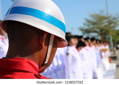 MAKASSAR, INDONESIA - AUGUST 17 2018: A soldier wearing a helmet is looking down at the commemoration ceremony of Indonesia's independence proclamation at Losari Beach, Makassar