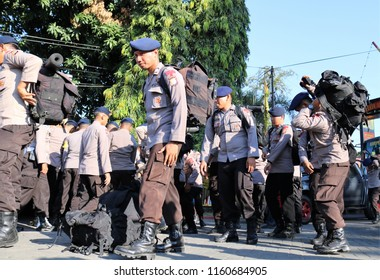 MAKASSAR, INDONESIA - AUGUST 20 2018: South Sulawesi Police Officers prepare to leave for Lombok to help earthquake victims and be released by the South Sulawesi Regional Police Chief in Makassar