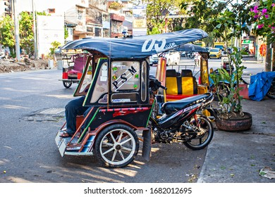 Makassar, Indonesia : Bentor is a traditional public transports using in the city area. Bentor stands for Becak Motor which is a three-wheeled vehicle, rickshaw with motorcycle (10/2019).