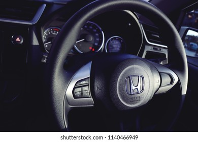 MAKASSAR, INDONESIA - JULY 22 2018: The inside of a car with a beautiful steering wheel. This vehicle drove on the streets of Makassar