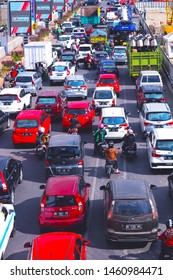 MAKASSAR, INDONESIA - JULY 25 2019: Traffic congestion conditions on Jalan AP Pettarani, Makassar City, South Sulawesi, due to the construction of overpasses from 4 kilometers