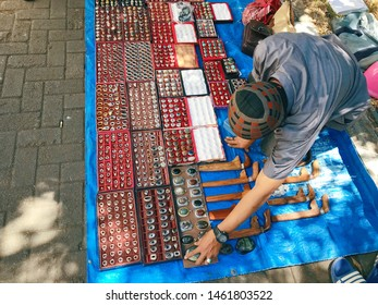 MAKASSAR, INDONESIA - JULY 26 2019: Ring stone traders are peddling their sales in the courtyard of the mosque in Makassar