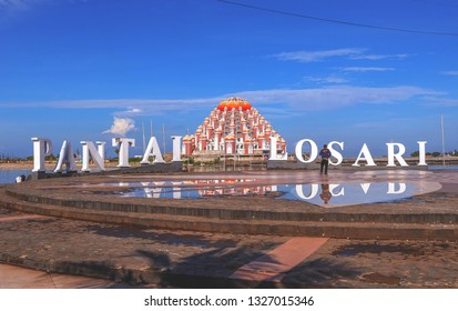 MAKASSAR, INDONESIA - MARCH 2 2019: The atmosphere of Losari Beach with a unique mosque background in the city of Makassar