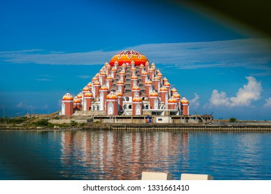 MAKASSAR, INDONESIA - MARCH 5 2019: Losari Beach in Makassar City with 99 domes of mosque background