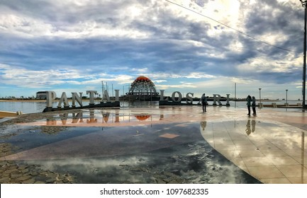 MAKASSAR, INDONESIA - MAY 24 2018: The atmosphere at Losari Beach. Losari Beach is one of the favorite locations of tourists who visit the city of Makassar to simply gather and enjoy the sunset