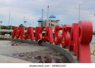 MAKASSAR, INDONESIA - MAY 24 2018: Beach Pavilion Losari with the background of Amirul Mukminin Mosque which is a floating mosque in Makassar. This place is visited by many tourists