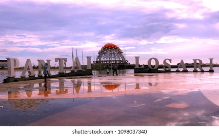MAKASSAR, INDONESIA - MAY 24 2018: Losari Beach with its beauty visited by many tourists both local and international, with locations in Makassar. Looks beautiful clouds ahead of the sunset