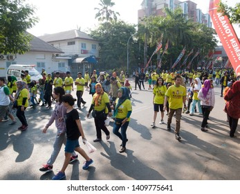 Makassar, Indonesia - November 1, 2015: Thousands people take part in healty walk event during car free day event at Losari Beach.