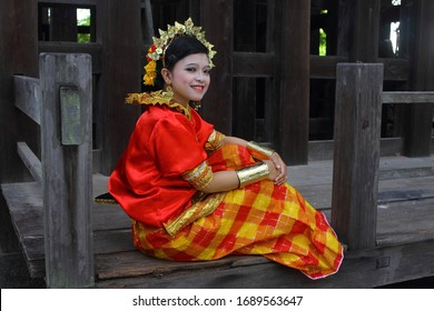 Makassar, Indonesia - November 2013 - Buginese Baju Bodo Ethnic Traditional Costume